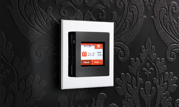 NGTouch black thermostat with a polished chrome surround